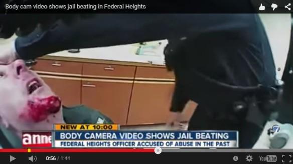 Police beating man